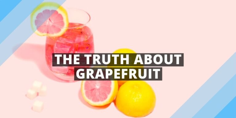 glass of grapefruit and grapfruis cut half