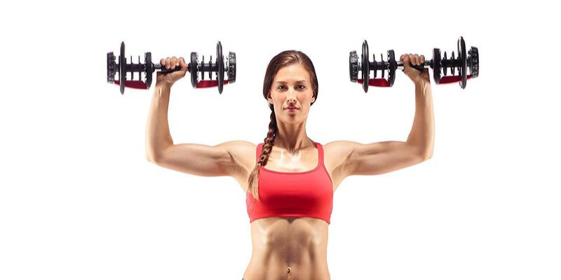 a woman exercising with adjustable dumbbells