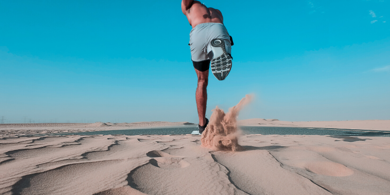 a man running on the sand