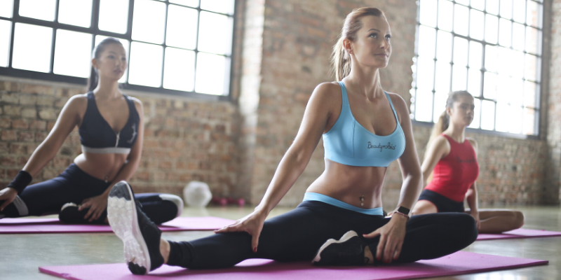 women stretching in the gym