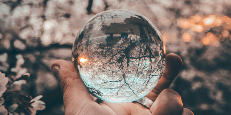 a glass ball in a hand