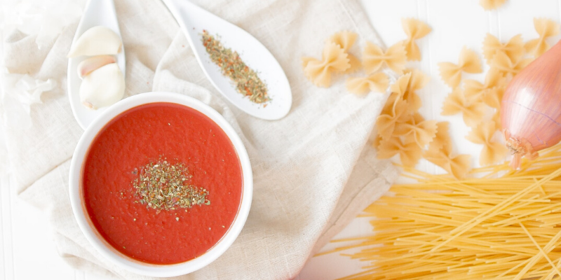 bowl with pasta sauce and spaghetti