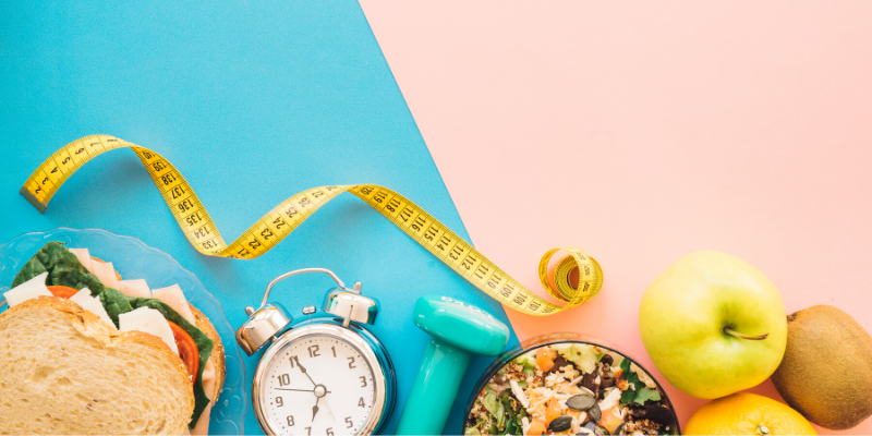measuring tape, alarm clock and healthy food