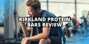 a man sitting on a gym bench eating protein bar