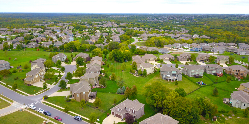 a drone view on a neighborhood with lots of green space