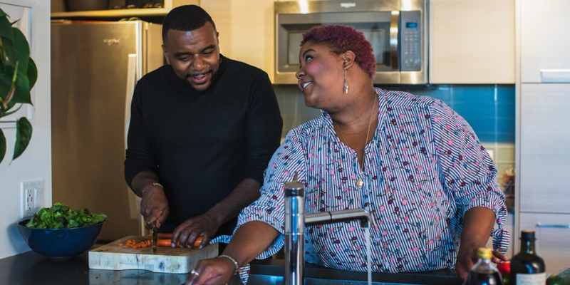 plus size woman and a man cooking