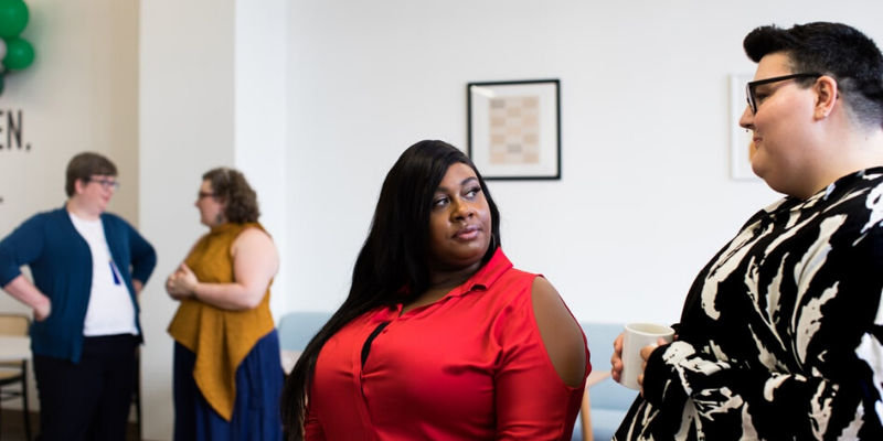 a plus size woman looking looking at a plus size man