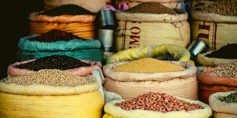 different legumes in big bags in a market