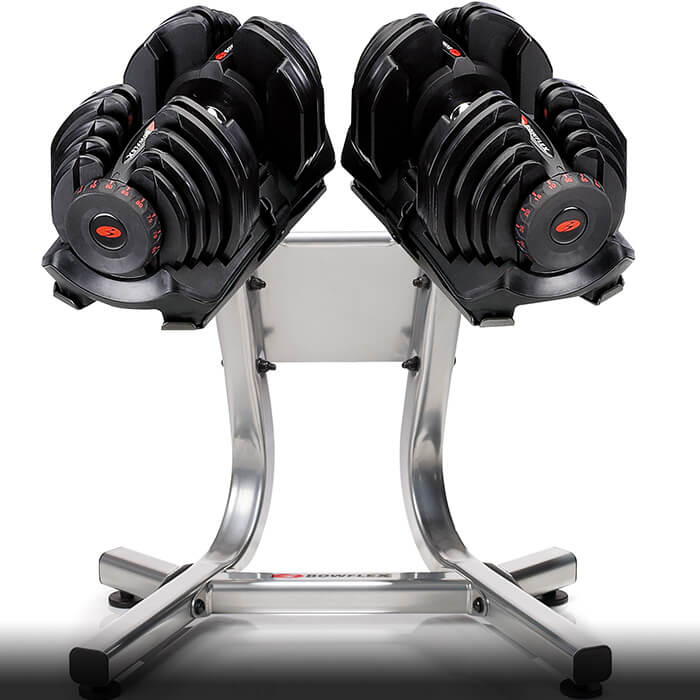 bowflex adjustable dumbbells on a stand