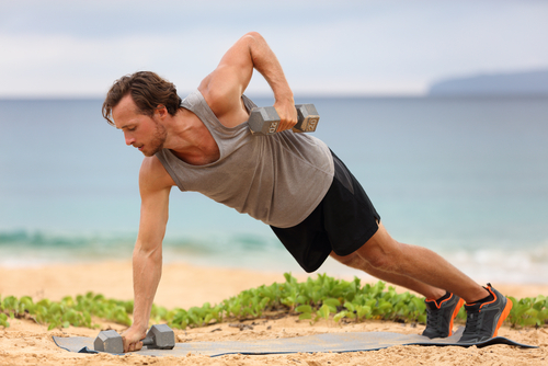 man training dumbbells plank row exercise lifting dumbbell weights